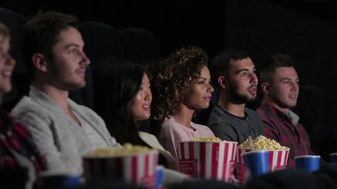 Friends in cinema watching a movie Footage