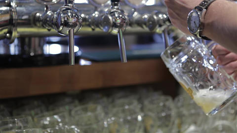 Close-up of barman hand pouring a lager beer Live Action