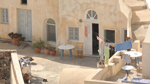 Courtyard of residential household on summer sunny day, towels hanging on ropes Footage