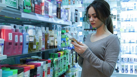 Woman at pharmacy buying shampoo Footage