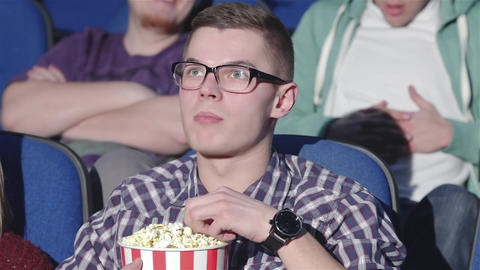 Man shows a gesture of Shh in the cinema Live Action