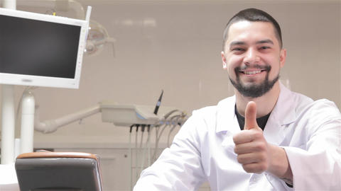 Dentist show his thumb up at the cabinet Footage