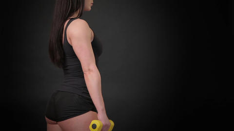 Fitness woman bends her arms Stock Video Footage