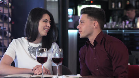 Couple have a conversation at the restaurant Footage