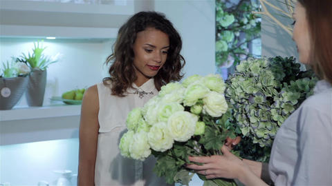 Female buyer examines the bouquet of roses Footage