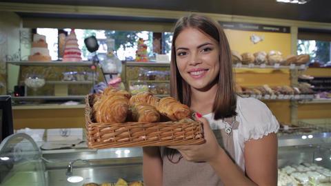 Woman smells croissants Live Action