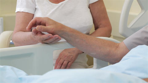 Senior ill man put his hand on his wife's palm Footage