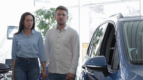 Couple looks inside the blue SUV Live Action