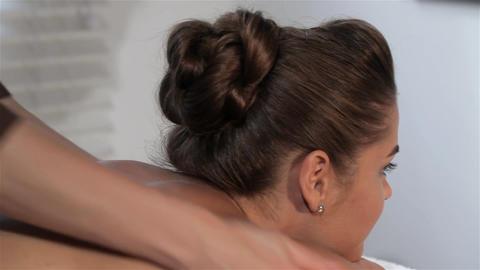 Female hands massages woman's neck Footage