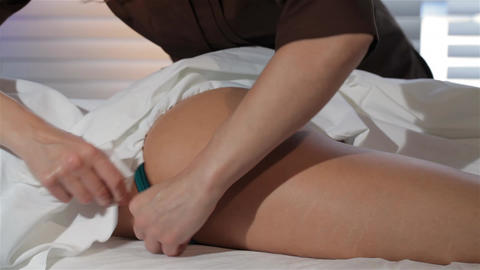 Female masseur covers female body by the sheet Footage