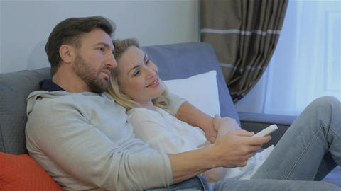 Couple watches TV at home Footage