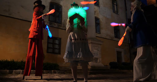 4k Alice in wonderland - performance with jugglers, led lights, stilts and magic GIF