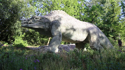 Dinosaur sculpture at Crystal Palace London UK Footage