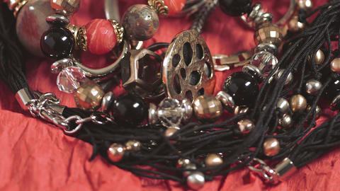 Various designer jewelry lying on the table Footage