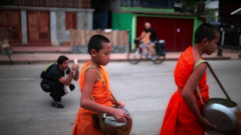Morning alms giving ceremony in Luang Prabang city, Laos Footage