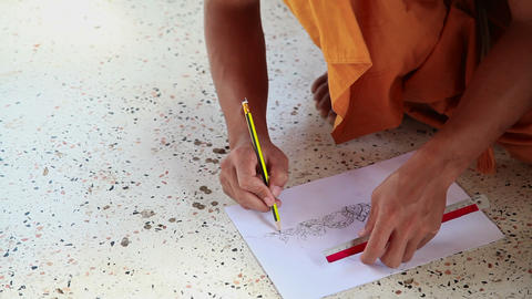 Monk drawing the picture in the monastery Footage
