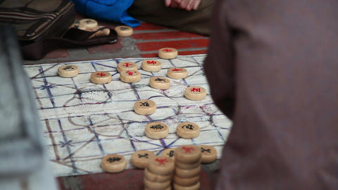 Close up shot of hands playing board game in park Footage