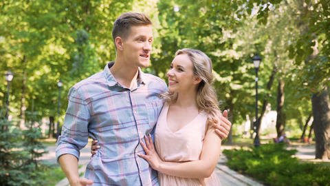Handsome guy enthusiastically telling fascinating story to his girlfriend, date Footage