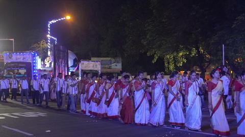 Bengali ladies wearnig sari walking in Durga Puja carnival Footage