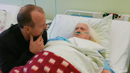 Old, Ill woman and her family member are talking in hospital room ビデオ