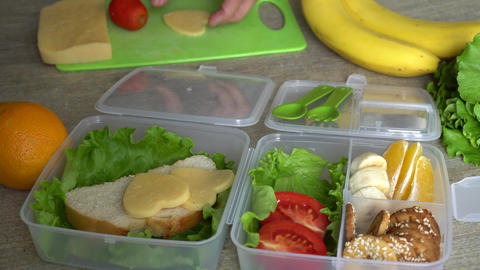 Mother Putting Food In Lunch Box Live Action