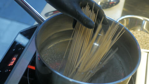 Spaghetti boiling in hot water on the stove Live Action