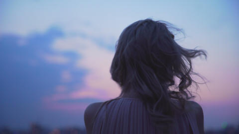 Lonely girl shaking from cold wind, standing on edge of roof, loneliness Footage