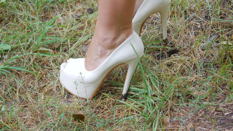 High-heeled shoes on the grass, women's shoes presentation, women's shoes Footage