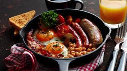 Full English breakfast on dark rusty background Footage