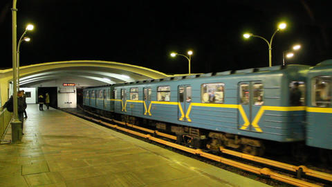 Electric train leaving station in subway in evening. Train leaving metro station Live Action