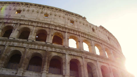 fantastic tracking shot with gimbal on the facade of the Colosseum on a sunny Live Action