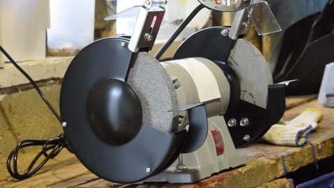Grinding wheels grinding machine. Electric sharpened. Type of equipment for sharpening tools Footage
