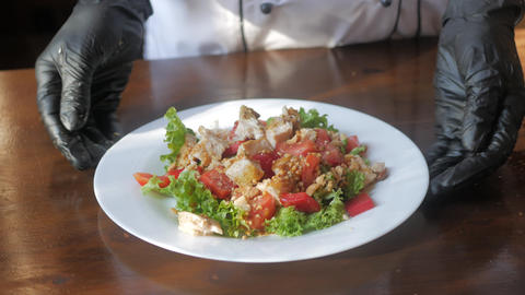 Closeup of Human hands cooking vegetables salad in kitchen ライブ動画