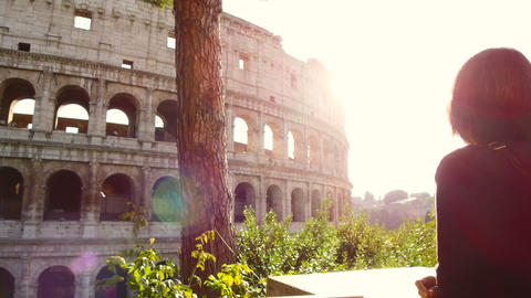 tourist woman looks enchanted the majestic Colosseum of Rome Footage
