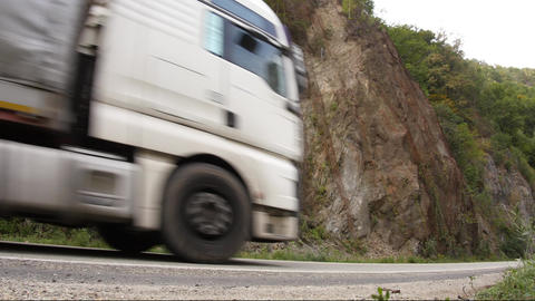 Camcorder left on the road near a cliff captures the speed cars on road 93b Footage