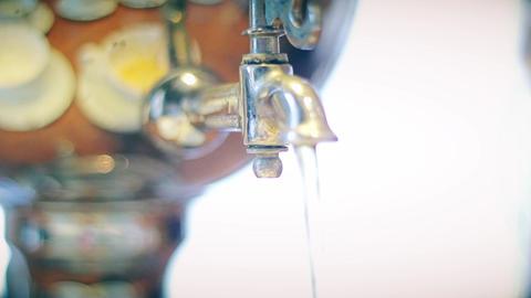 Samovar pouring boiling tea close-up 2 Live Action