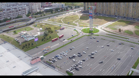 aerial view shopping mall parking area and park on day Live Action