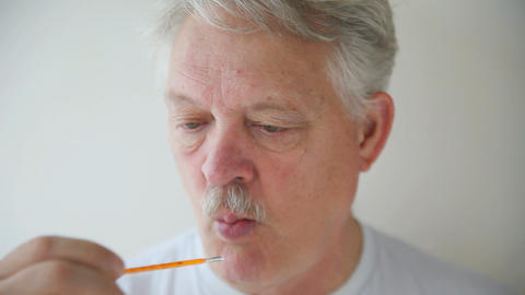 Sick man surprised by high fever Live Action