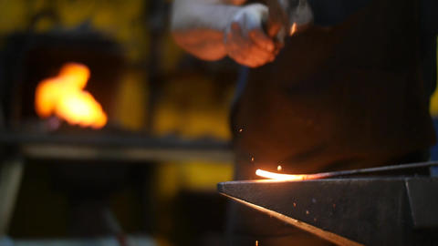 Forging a Sword on an Anvil in a Blacksmith Workshop Footage
