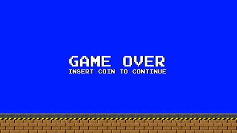 Old Video Arcade Platform Game Over on a Blue Screen Live Action