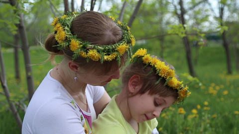 Mother and daughter sitting in the flower meadow Footage