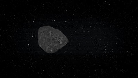 Asteroid Hovering in Outer Space with Stars Footage