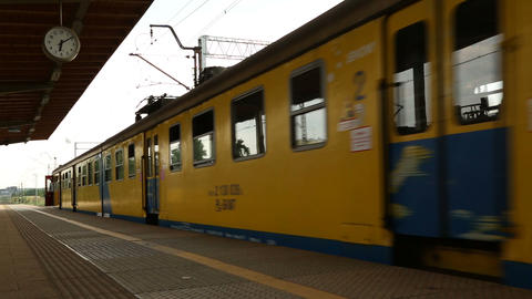 Yellow and blue city suburban train leaving station, destination, transportation Live Action