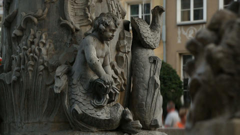 Fountain with old sculptures against city square, historical downtown, tourism Footage