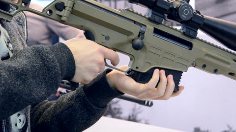 Weapon optics sight of sniper rifle with man close-up in…, Live Action