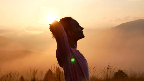 Happy Winning Success Woman at Sunset or Sunrise Standing Elated with Arms Footage