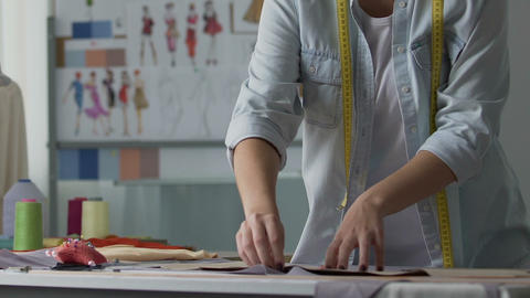 Sewing course student attaching pattern with pins, inspired creative process Live Action