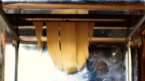 fresh pasta making of homemade fresh pasta tagliatelle with egg and flour Live Action