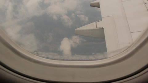 Earth And Clouds From Airplane Window GIF