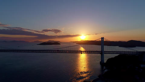 Aerial - Sunset and scenery of the Seto Inland Sea and the Seto Ohashi Bridge Archivo